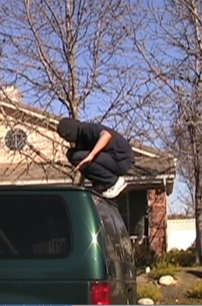 Screenshot from Squirt's latest movie: Ninja on top of van